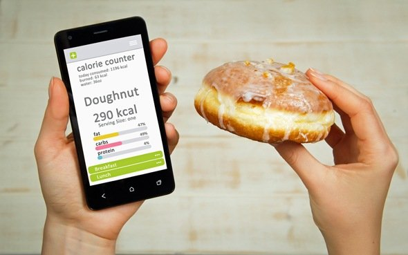 hands-holding-phone-and-donut